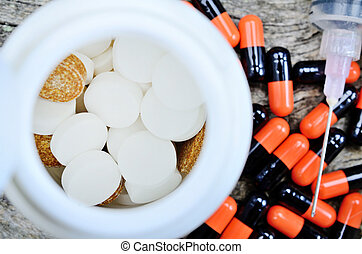 pills on wooden table