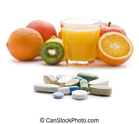 Pills with fresh fruit in background isolated