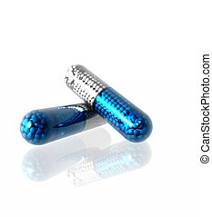 Pills - Two pills on a reflective surface.