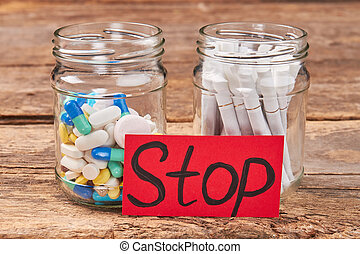 Pills, tobacco cigarettes, message stop.