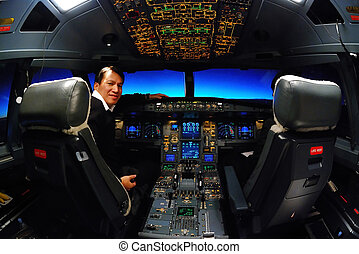 captain was sitting in airbus A330 plane cockpit with many controllers and switches