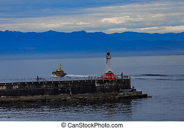 Pilot Boat and Lighthouse at Dawn