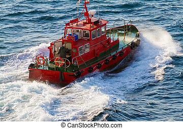 Pilot boat departing