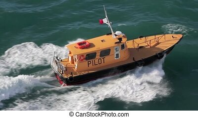 Pilot Boat in Caribbean Waters - Yellow pilot boat steaming...