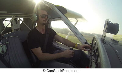 Pilot flying on small airplane
