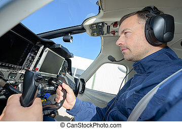 Pilot in aircraft