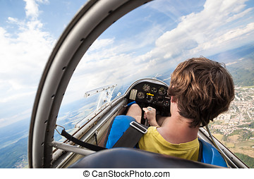 pilot in cockpit of a plane