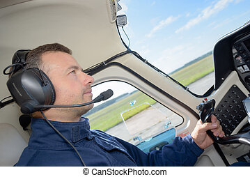 Pilot in cockpit of aircraft