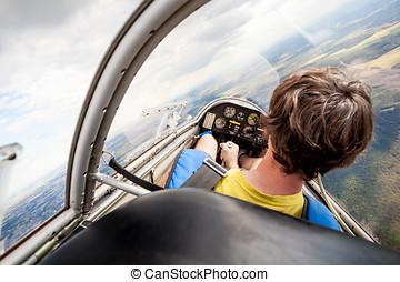 pilot in cockpit of glider in tilt
