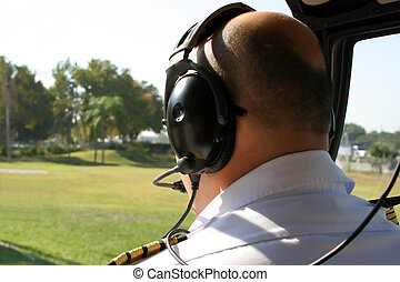 pilot in cockpit of helicopter