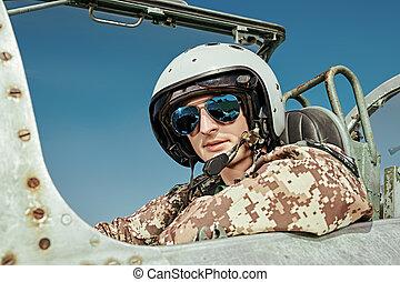 pilot in helmet and sunglasses