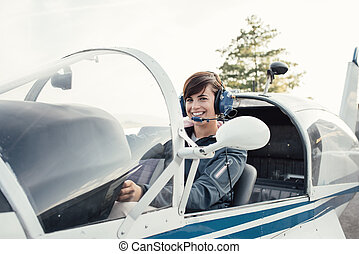 Pilot in the aircraft cockpit