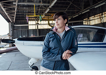 Pilot leaning on a light aircraft