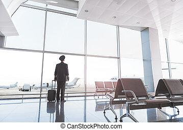 Pilot locating near glass wall - Airman is standing near ...