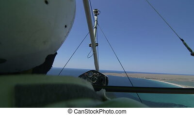 Pilot of hang glider flying - Pilot of motorized hang glider...
