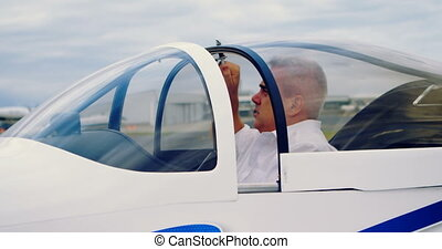 Pilot ready to start the aircraft 4k - Male pilot ready to...