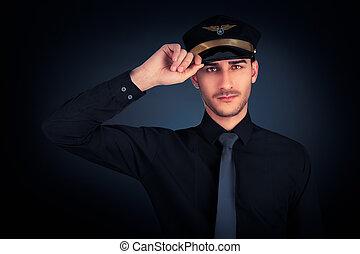 Pilot Salute Low Key Portrait - Young pilot wearing black...