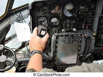 pilot steering a plane - closeup of a pilots hand steering a...