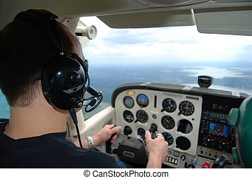 Pilot Training - Pilot training in a small aircraft over a...