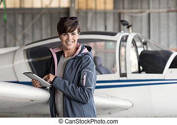 Pilot using a digital tablet