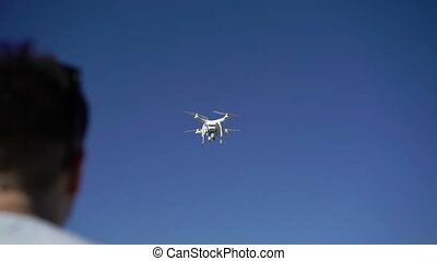 Pilot using quadcopter in the air