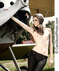 Pilot. Vintage airplane with beauty young pilot