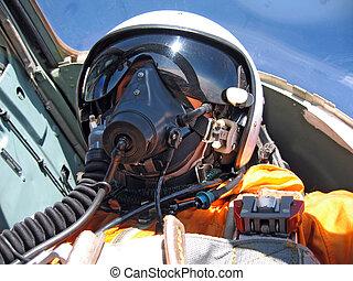 piloto militar, en, el, avión, en, un, casco, en, azul oscuro, overol, contra, el, cielo azul