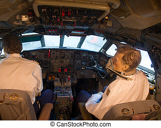 dummy pilots in cockpit of an old plane