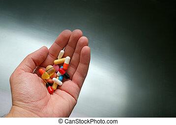 pilules, main