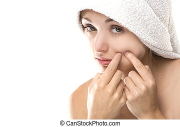 Pimple , spot on beauty woman face with a white towel