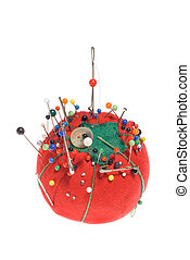 The concept of sewing and embroidery is highlighted by a well used 75 year old push pin cushion.