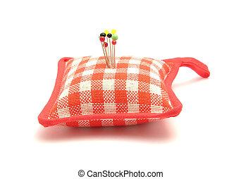 Pin cushion with several pins
