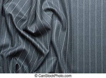 Pin striped suit with creases