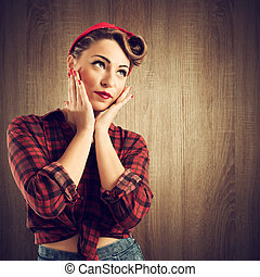 Pin-up 50 years - Pretty pin-up girl posing with hairstyle...