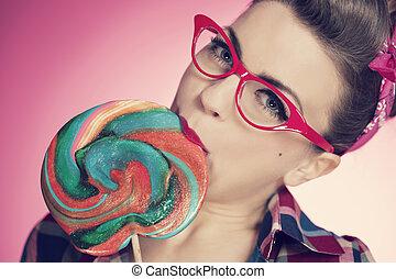 Pin up girl eating lollipop
