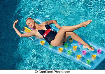 Pin up girl in the swimming pool
