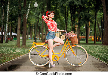 Pin-up girl on bicycle, vintage american fashion - Pin-up...