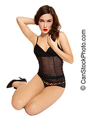 Pin-up girl - Sexy slim girl in black lingerie sitting on...