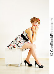 Pin-up girl on light background
