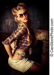pin-up style - Charming pin-up woman with retro hairstyle...