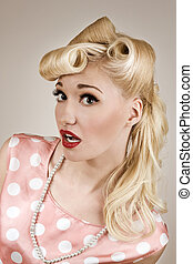 Pin-up style portrait of surprised girl