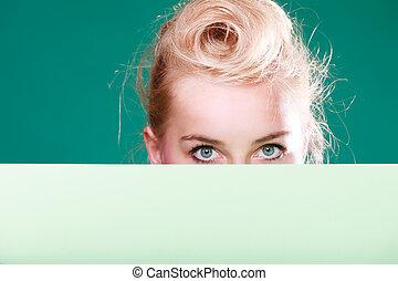 Pin up woman eyes behind white sign