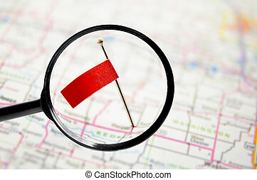 pin with stuck into a map with magnifying glass