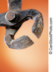 Old worn metallic carpenter's pincer in closeup. Extremely short depth-of-field.