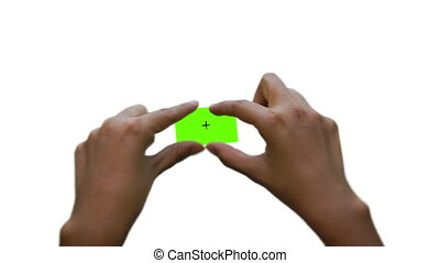 A person pinching and zooming a green screen