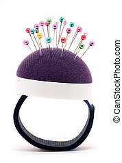 Purple pincushion bracelet with pins isolated on white