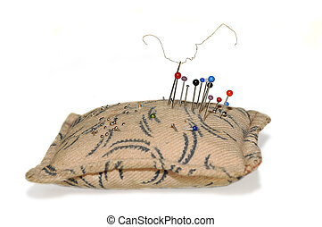Nneedles and pins in pincushion