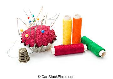 Pincushion, thimble and threads