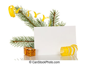 Pine branch decorated with yellow serpentine, small gifts and blank greeting card, isolated on white