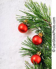 Pine branch - Green pine tree branch with Christmas balls on...